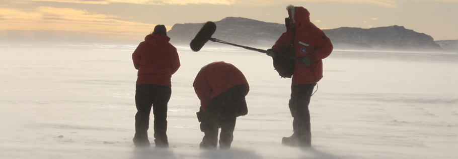 Left to right, producer and director Anne Aghion, director of photography Sylvestre Guidi, and sound recordist Richard Fleming, filming the snakes of snow in the wind, on the sea ice not far from Scott's Hut at Cape Evans.